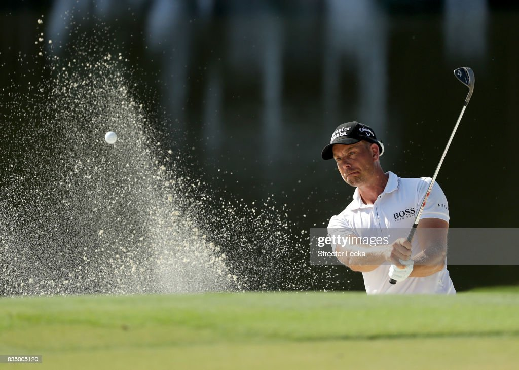 Henrik Stenson of Sweden hits a shot from the sand on the 15th hole during the second round of the Wyndham Championship at Sedgefield Country Club on August 18, 2017 in Greensboro, North Carolina.
