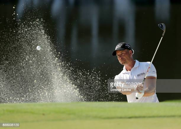 Henrik Stenson of Sweden hits a shot from the sand on the 15th hole during the second round of the Wyndham Championship at Sedgefield Country Club on...