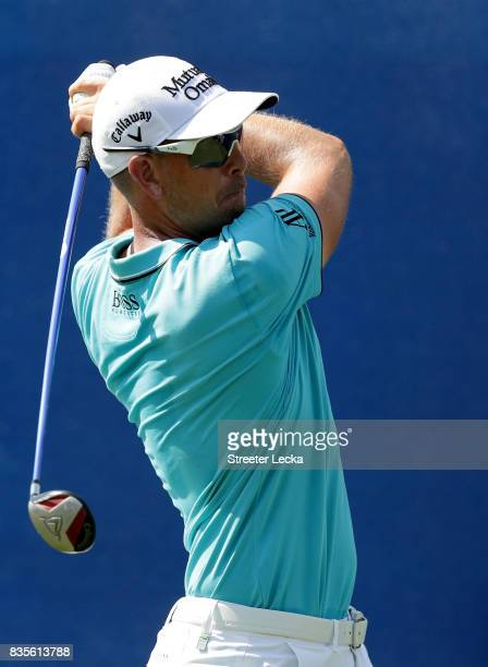 Henrik Stenson of Sweden hits a tee shot on the 10th hole during the third round of the Wyndham Championship at Sedgefield Country Club on August 19...