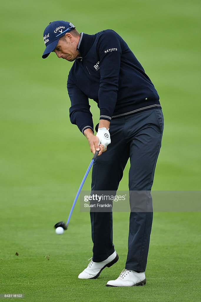 Henrik Stenson of Sweden hits an approach shot during the rain delayed third round of the BMW International Open at Gut Larchenhof on June 26, 2016 in Cologne, Germany.