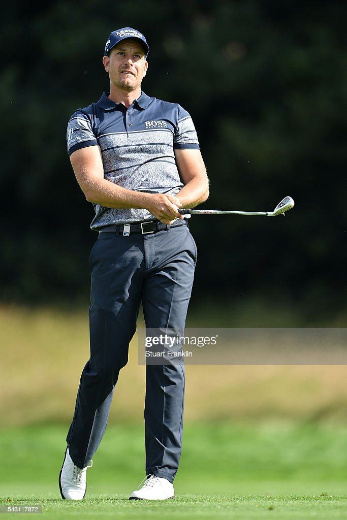<a gi-track='captionPersonalityLinkClicked' href=/galleries/search?phrase=Henrik+Stenson&family=editorial&specificpeople=211537 ng-click='$event.stopPropagation()'>Henrik Stenson</a> of Sweden hits an approach shot during the rain delayed third round of the BMW International Open at Gut Larchenhof on June 26, 2016 in Cologne, Germany.