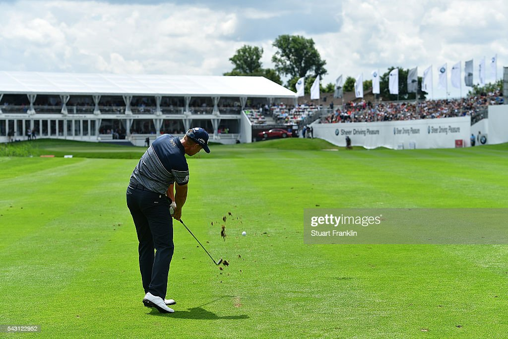 <a gi-track='captionPersonalityLinkClicked' href=/galleries/search?phrase=Henrik+Stenson&family=editorial&specificpeople=211537 ng-click='$event.stopPropagation()'>Henrik Stenson</a> of Sweden hits an approach shot on the 18th hole during the rain delayed third round of the BMW International Open at Gut Larchenhof on June 26, 2016 in Cologne, Germany.