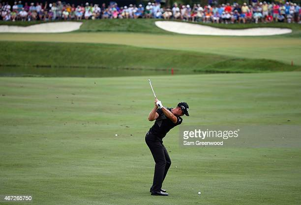 Henrik Stenson of Sweden hits an approach shot on the eighth hole during the final round of the Arnold Palmer Invitational Presented By MasterCard at...