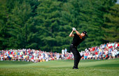 Henrik Stenson of Sweden hits an approach shot on the seventh hole during the final round of the 96th PGA Championship at Valhalla Golf Club on...