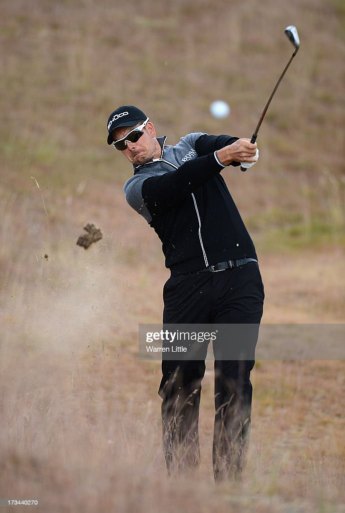 <a gi-track='captionPersonalityLinkClicked' href=/galleries/search?phrase=Henrik+Stenson&family=editorial&specificpeople=211537 ng-click='$event.stopPropagation()'>Henrik Stenson</a> of Sweden hits his 2nd shot on the 6th hole during the final round of the Aberdeen Asset Management Scottish Open at Castle Stuart Golf Links on July 14, 2013 in Inverness, Scotland.