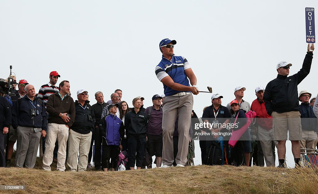 <a gi-track='captionPersonalityLinkClicked' href=/galleries/search?phrase=Henrik+Stenson&family=editorial&specificpeople=211537 ng-click='$event.stopPropagation()'>Henrik Stenson</a> of Sweden hits his approach to the 18th green during the third round of the Aberdeen Asset Management Scottish Open at Castle Stuart Golf Links on July 13, 2013 in Inverness, Scotland.