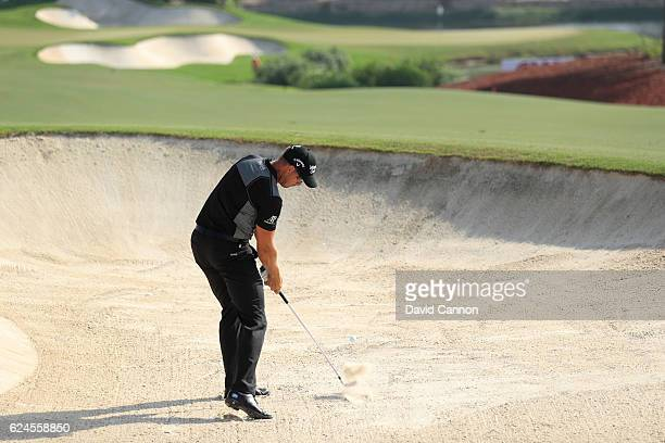Henrik Stenson of Sweden hits his second shot on the 16th hole during day four of the DP World Tour Championship at Jumeirah Golf Estates on November...