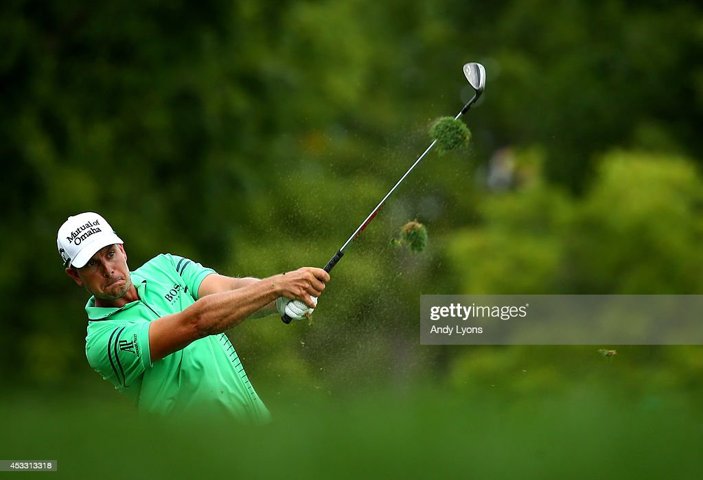 Henrik Stenson of Sweden hits his second shot on the 17th hole during the first round of the 96th PGA Championship at Valhalla Golf Club on August 7, 2014 in Louisville, Kentucky.