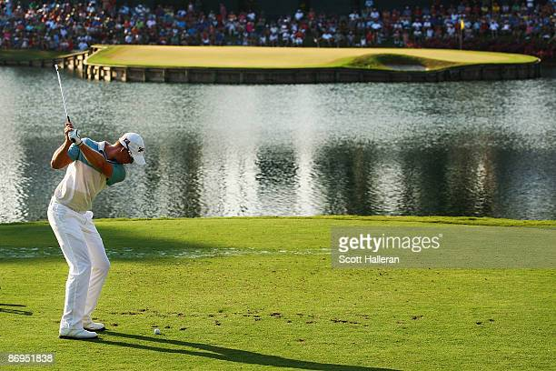 Henrik Stenson of Sweden hits his tee shot on the 17th hole during the final round of THE PLAYERS Championship on THE PLAYERS Stadium Course at TPC...