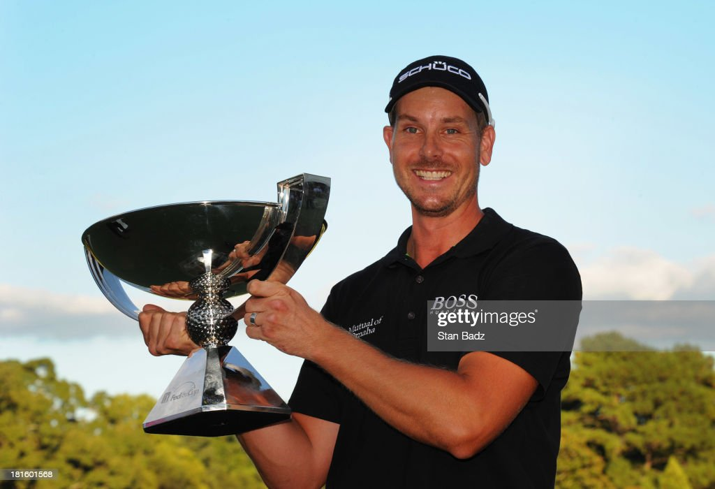 Henrik Stenson of Sweden holds the FedExCup after winning the TOUR Championship by Coca-Cola, the final event of the PGA TOUR Playoffs for the FedExCup, at East Lake Golf Club on September 22, 2013 in Atlanta, Georgia.