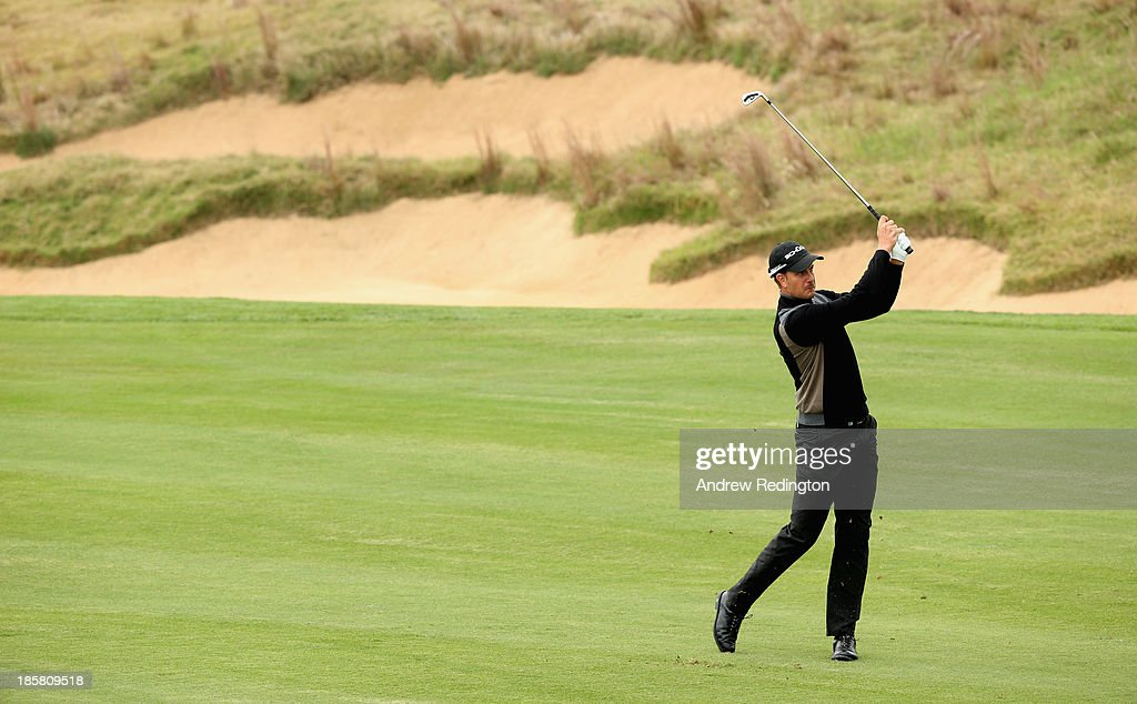Henrik Stenson of Sweden in action during the second round of the BMW Masters at Lake Malaren Golf Club on October 25, 2013 in Shanghai, China.