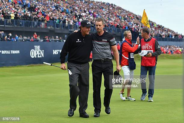 Henrik Stenson of Sweden is congratulated on his victory by Phil Mickelson of the United States on the 18th green during the final round on day four...