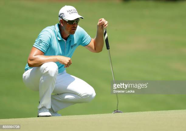 Henrik Stenson of Sweden line up a putt on the first hole during the third round of the Wyndham Championship at Sedgefield Country Club on August 19...