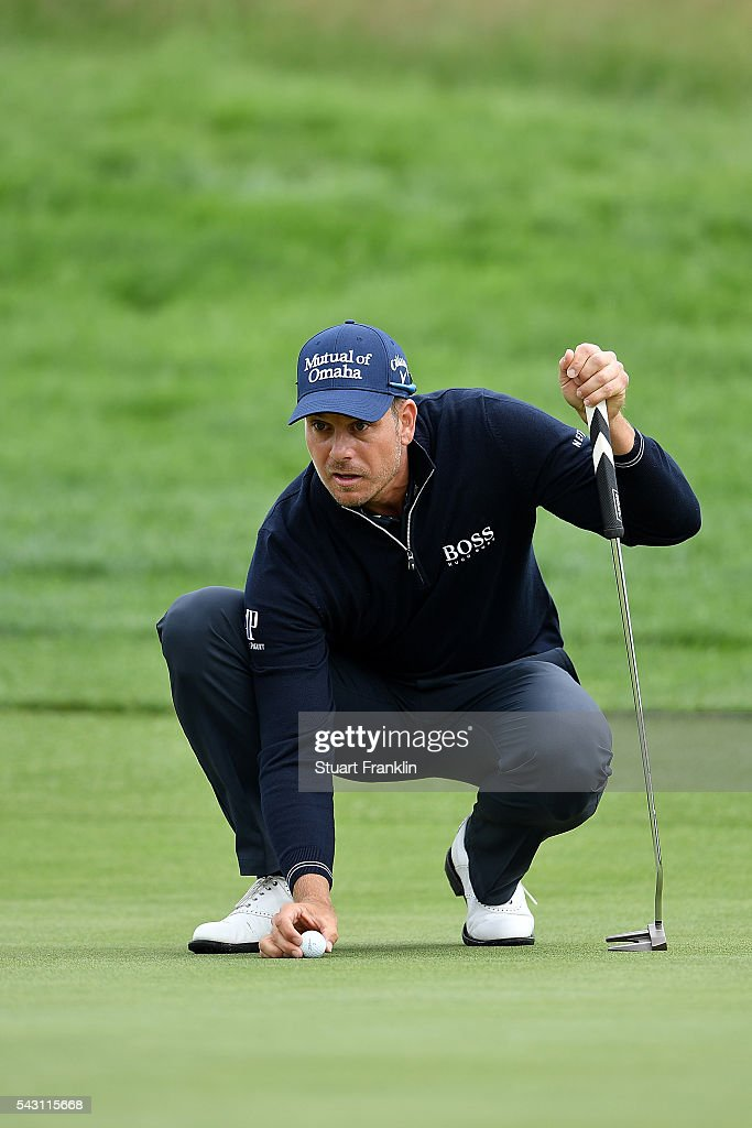 Henrik Stenson of Sweden lines up a putt during the rain delayed third round of the BMW International Open at Gut Larchenhof on June 26, 2016 in Cologne, Germany.