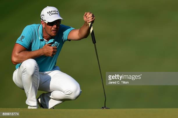 Henrik Stenson of Sweden lines up a putt on the 18th green during the third round of the Wyndham Championship at Sedgefield Country Club on August 19...