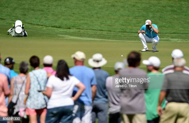 Henrik Stenson of Sweden lines up a putt on the eighth green during the third round of the Wyndham Championship at Sedgefield Country Club on August...