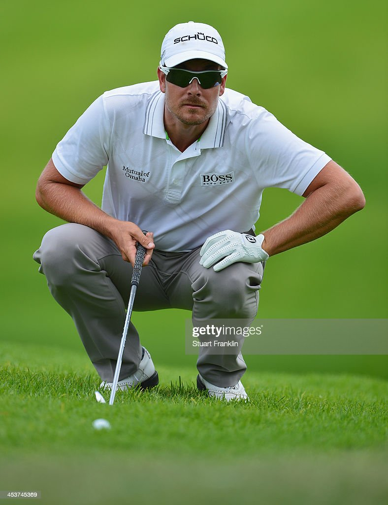 Henrik Stenson of Sweden lines up a shot during the first round of the Nedbank Golf Challenge at Gary Player CC on December 5 2013 in Sun City South...