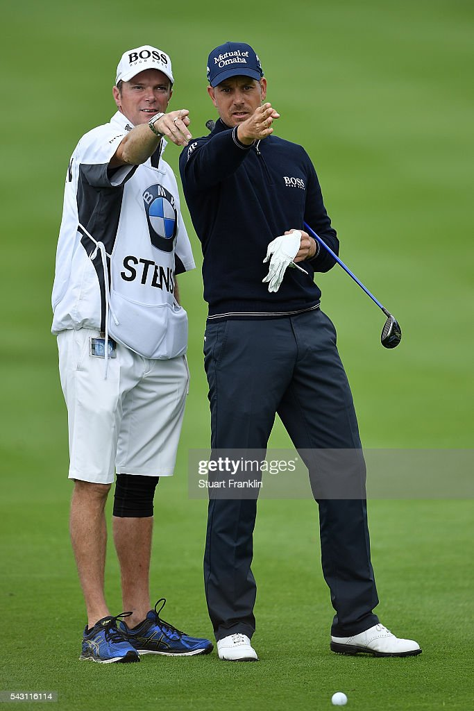 Henrik Stenson of Sweden lines up a shot with his caddie during the rain delayed third round of the BMW International Open at Gut Larchenhof on June 26, 2016 in Cologne, Germany.