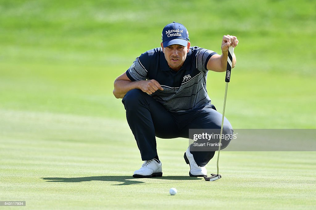 <a gi-track='captionPersonalityLinkClicked' href=/galleries/search?phrase=Henrik+Stenson&family=editorial&specificpeople=211537 ng-click='$event.stopPropagation()'>Henrik Stenson</a> of Sweden lines up during the rain delayed third round of the BMW International Open at Gut Larchenhof on June 26, 2016 in Cologne, Germany.