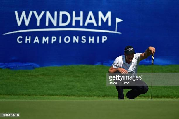 Henrik Stenson of Sweden lines up his par putt on the 18th green during the second round of the Wyndham Championship at Sedgefield Country Club on...