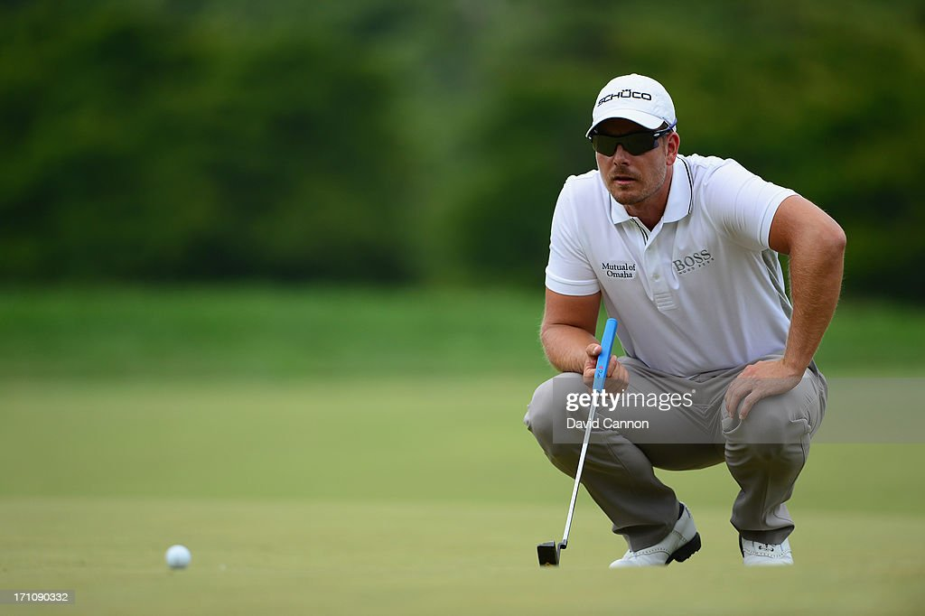 Henrik Stenson of Sweden lines up his putt on the first green during the final round of the 113th U.S. Open at Merion Golf Club on June 16, 2013 in Ardmore, Pennsylvania.