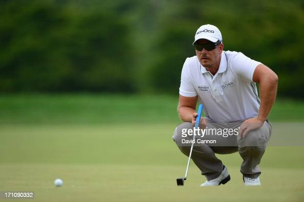Henrik Stenson of Sweden lines up his putt on the first green during the final round of the 113th US Open at Merion Golf Club on June 16 2013 in...