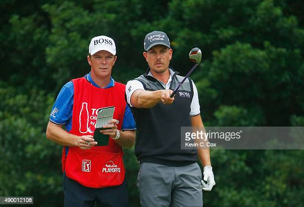 Henrik Stenson of Sweden lines up his tee shot on the eighth hole with his caddie Gareth Lord during the second round of the TOUR Championship By...
