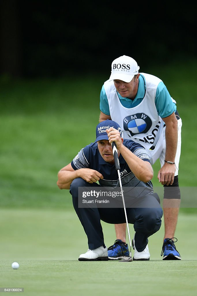 <a gi-track='captionPersonalityLinkClicked' href=/galleries/search?phrase=Henrik+Stenson&family=editorial&specificpeople=211537 ng-click='$event.stopPropagation()'>Henrik Stenson</a> of Sweden lines up wit his caddie during the final round of the BMW International Open at Gut Larchenhof on June 26, 2016 in Cologne, Germany.