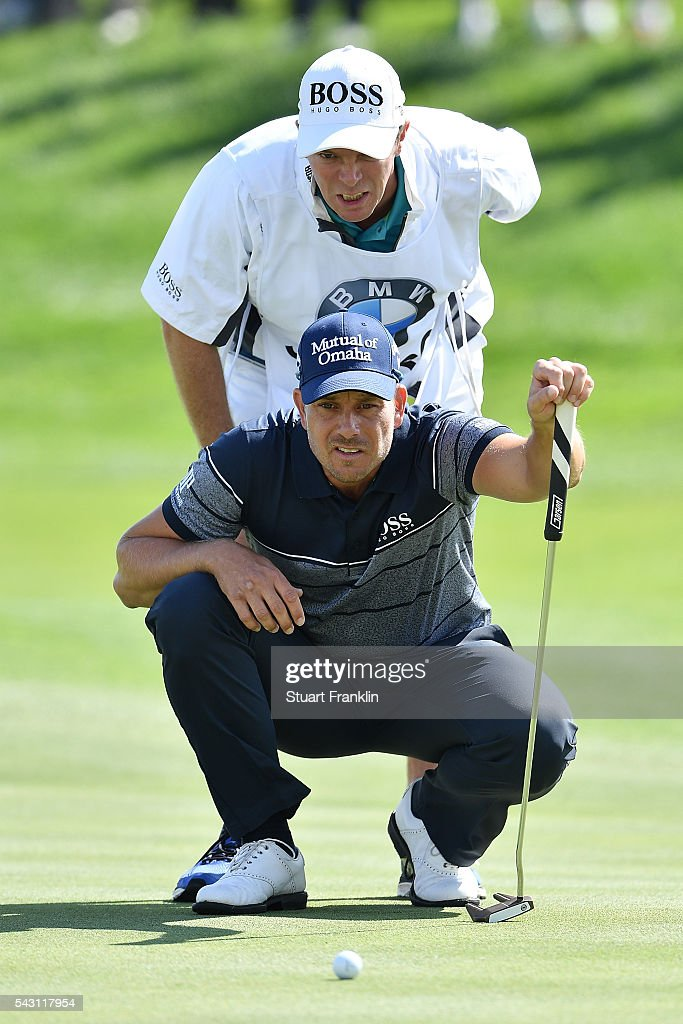 <a gi-track='captionPersonalityLinkClicked' href=/galleries/search?phrase=Henrik+Stenson&family=editorial&specificpeople=211537 ng-click='$event.stopPropagation()'>Henrik Stenson</a> of Sweden lines up with his caddie during the rain delayed third round of the BMW International Open at Gut Larchenhof on June 26, 2016 in Cologne, Germany.