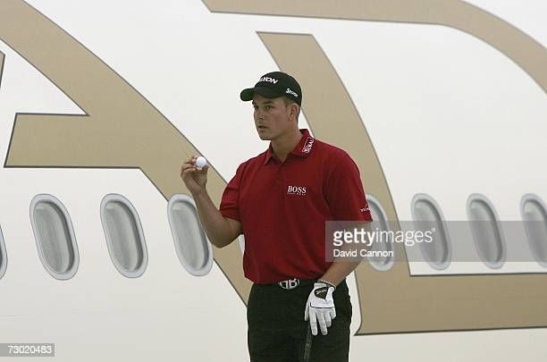 Henrik Stenson of Sweden looks at his ball before hitting his record drive of 721 yards during the 'Etihad Airways Swing on the Wing Challenge' while...