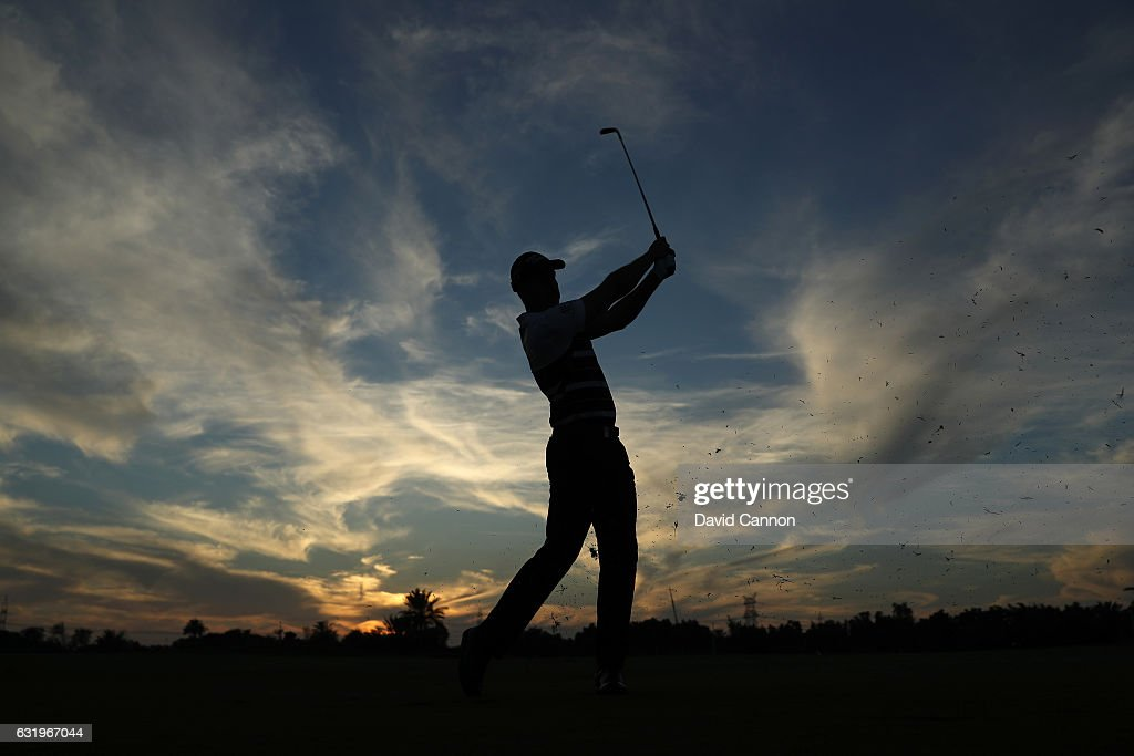 Henrik Stenson of Sweden plays a shot against the setting sun on his final hole during the pro-am for the 2017 Abu Dhabi HSBC Golf Championship at Abu Dhabi Golf Club on January 18, 2017 in Abu Dhabi, United Arab Emirates.