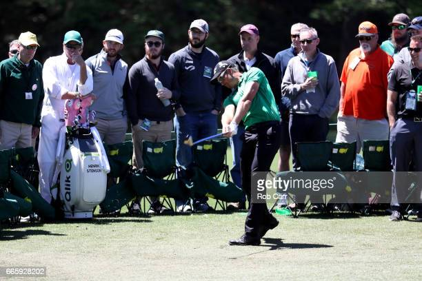 Henrik Stenson of Sweden plays a shot as caddie Gareth Lord looks on during the second round of the 2017 Masters Tournament at Augusta National Golf...