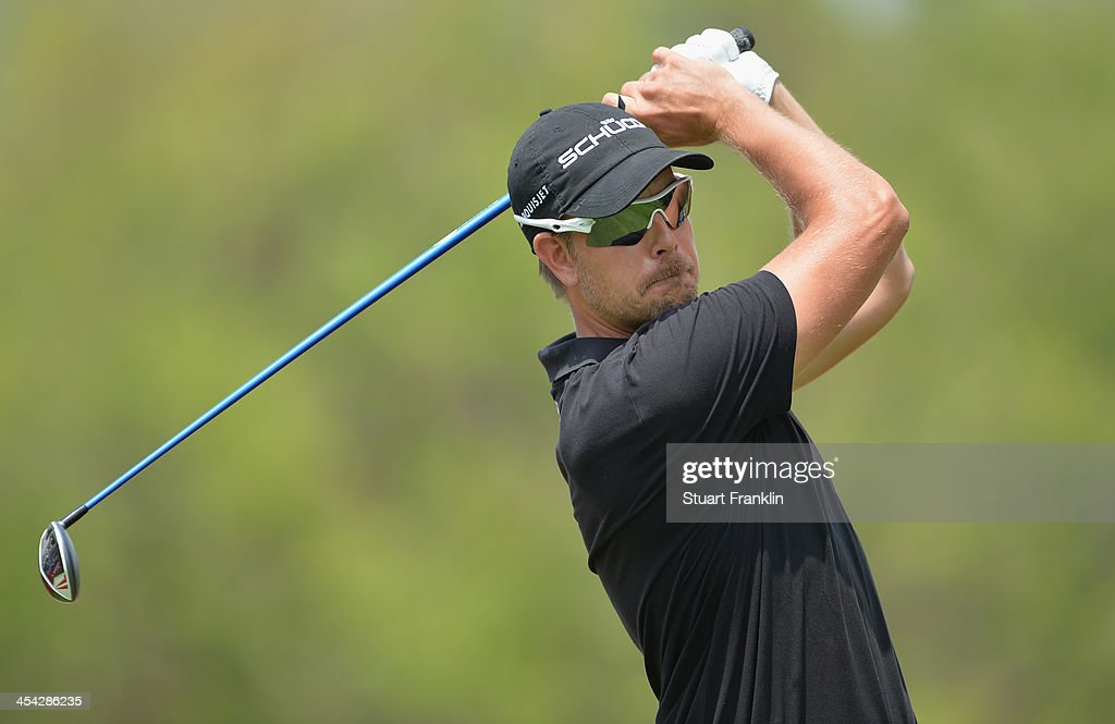 Henrik Stenson of Sweden plays a shot during the final round of the Nedbank Golf Challenge at Gary Player CC on December 8, 2013 in Sun City, South Africa.