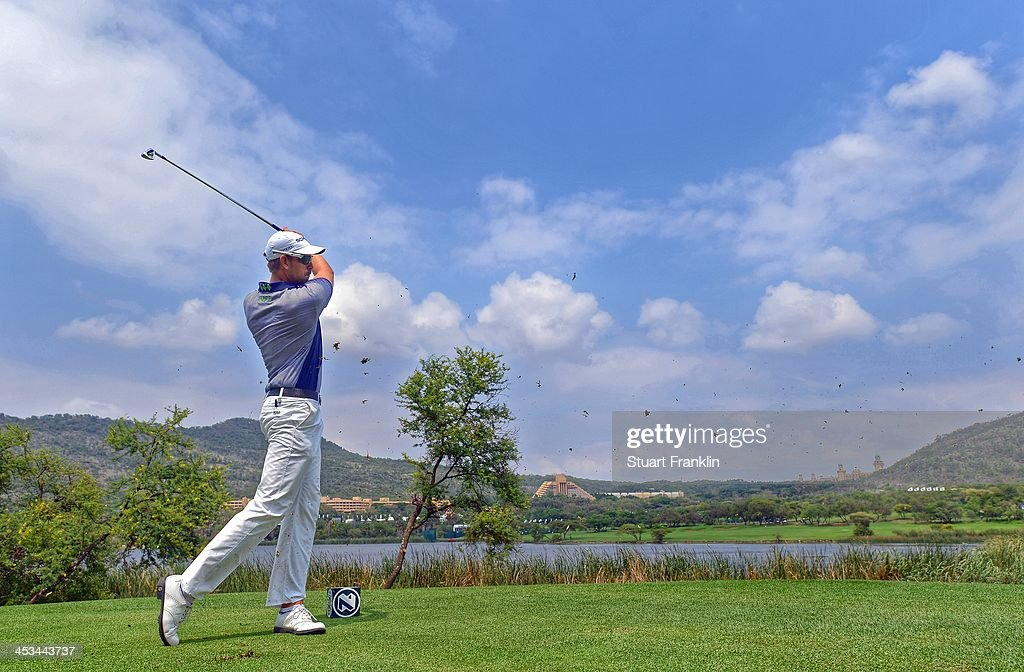. <a gi-track='captionPersonalityLinkClicked' href=/galleries/search?phrase=Henrik+Stenson&family=editorial&specificpeople=211537 ng-click='$event.stopPropagation()'>Henrik Stenson</a> of Sweden plays a shot during the pro - am prior to the start of the Nedban Golf Challenge at Gary Player CC on December 3, 2013 in Sun City, South Africa.