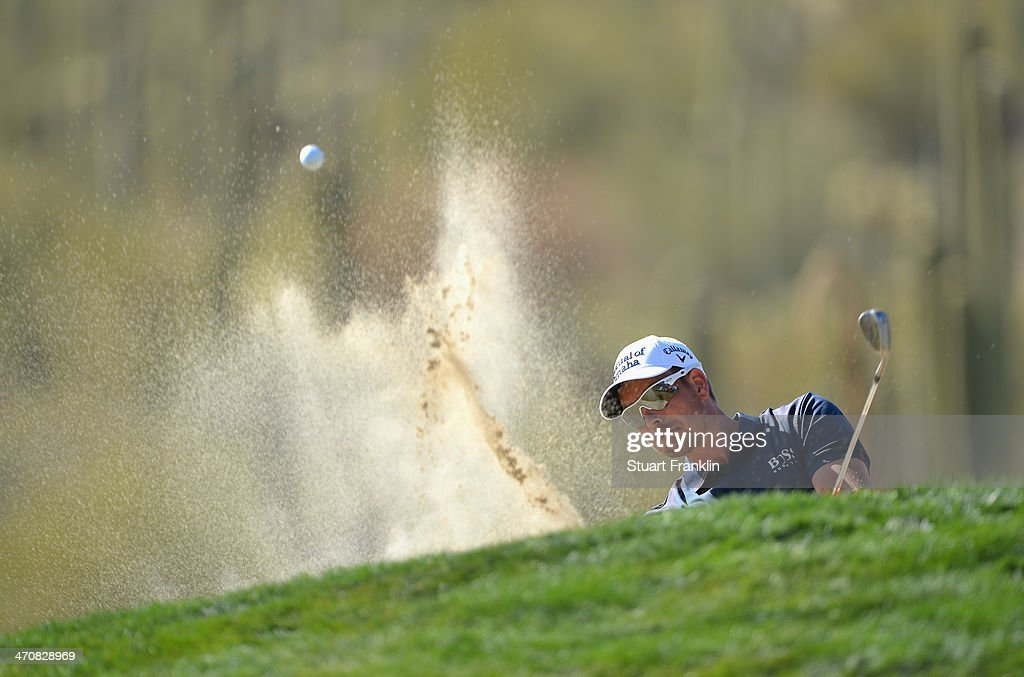 Henrik Stenson of Sweden plays a shot on the 15th hole during the second round of the World Golf Championships - Accenture Match Play Championship at The Golf Club at Dove Mountain on February 20, 2014 in Marana, Arizona.