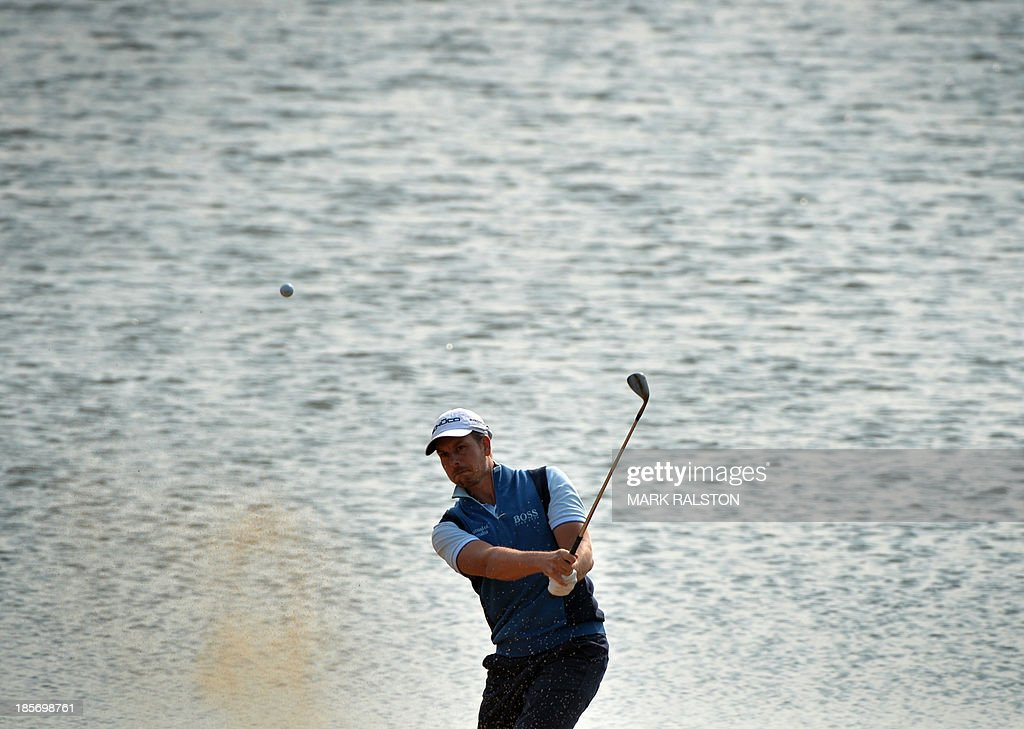 Henrik Stenson of Sweden plays from a bunker at the 9th hole during day one the BMW Shanghai Masters golf tournament at the Lake Malaren Golf Club in Shanghai on October 24, 2013. The 7 million USD event is being held for the second time at the Lake Malaren Golf Club. AFP PHOTO/Mark RALSTON