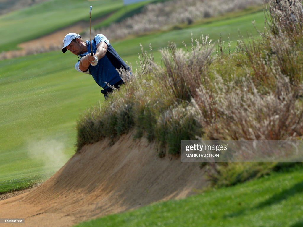 Henrik Stenson of Sweden plays from the rough at the 9th hole during day one the BMW Shanghai Masters golf tournament at the Lake Malaren Golf Club in Shanghai on October 24, 2013. The 7 million USD event is being held for the second time at the Lake Malaren Golf Club. AFP PHOTO/Mark RALSTON