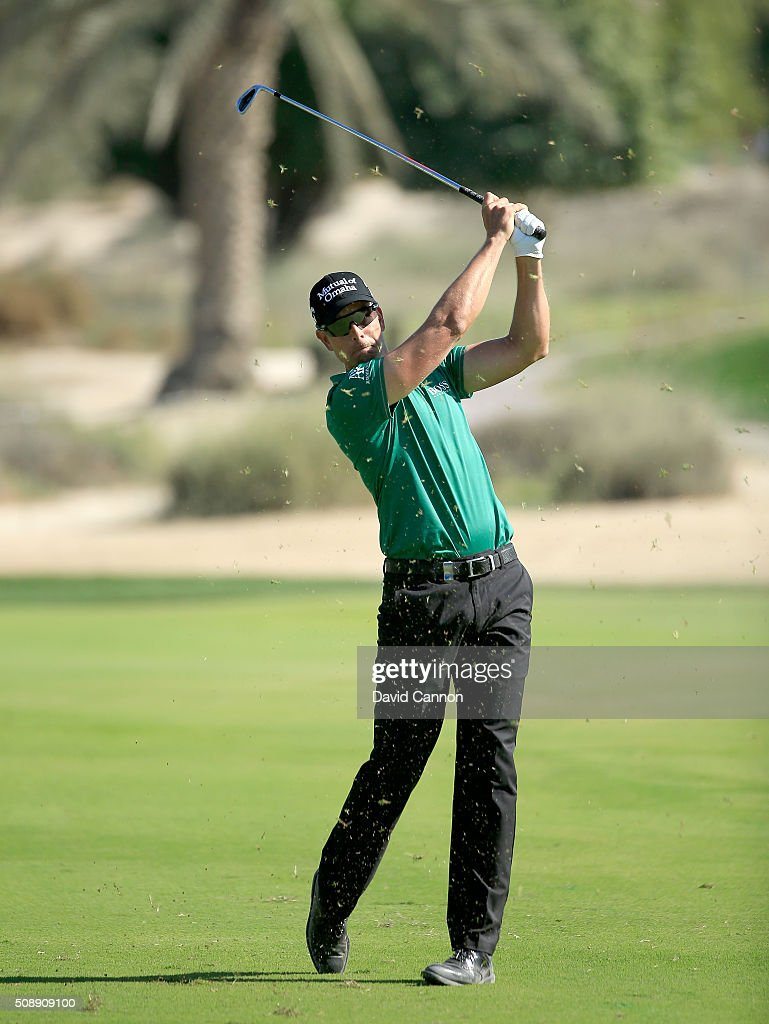 <a gi-track='captionPersonalityLinkClicked' href=/galleries/search?phrase=Henrik+Stenson&family=editorial&specificpeople=211537 ng-click='$event.stopPropagation()'>Henrik Stenson</a> of Sweden plays his second shot at the par 4, 16th hole during the final round of the 2016 Omega Dubai Desert Classic on the Majlis Course at the Emirates Golf Club on February 7, 2016 in Dubai, United Arab Emirates.