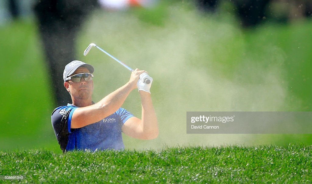 <a gi-track='captionPersonalityLinkClicked' href=/galleries/search?phrase=Henrik+Stenson&family=editorial&specificpeople=211537 ng-click='$event.stopPropagation()'>Henrik Stenson</a> of Sweden plays his second shot at the par 4, first hole during the third round of the 2016 Omega Dubai Desert Classic on the Majlis Course at the Emirates Golf Club on February 6, 2016 in Dubai, United Arab Emirates.