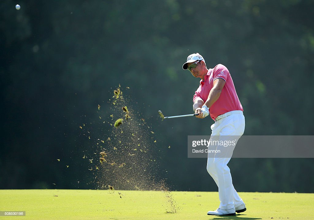 Henrik Stenson of Sweden plays his second shot at the par 4 second hole during the second round of the 2016 Omega Dubai Desert Classic on the Majlis...