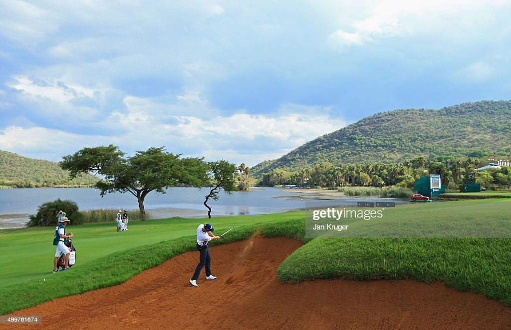 Henrik Stenson of Sweden plays his second shot on the 17th hole from a bunker during day one of the Nedbank Golf Challenge at Gary Player CC on...