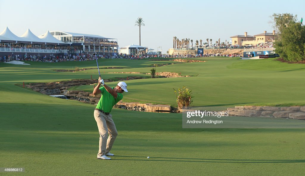<a gi-track='captionPersonalityLinkClicked' href=/galleries/search?phrase=Henrik+Stenson&family=editorial&specificpeople=211537 ng-click='$event.stopPropagation()'>Henrik Stenson</a> of Sweden plays his second shot on the 18th hole during the second round of the DP World Tour Championship at Jumeirah Golf Estates on November 21, 2014 in Dubai, United Arab Emirates.