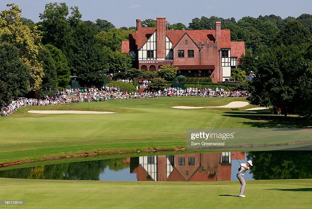<a gi-track='captionPersonalityLinkClicked' href=/galleries/search?phrase=Henrik+Stenson&family=editorial&specificpeople=211537 ng-click='$event.stopPropagation()'>Henrik Stenson</a> of Sweden plays his second shot on the ninth hole during the first round of the TOUR Championship by Coca-Cola at East Lake Golf Club on September 19, 2013 in Atlanta, Georgia.
