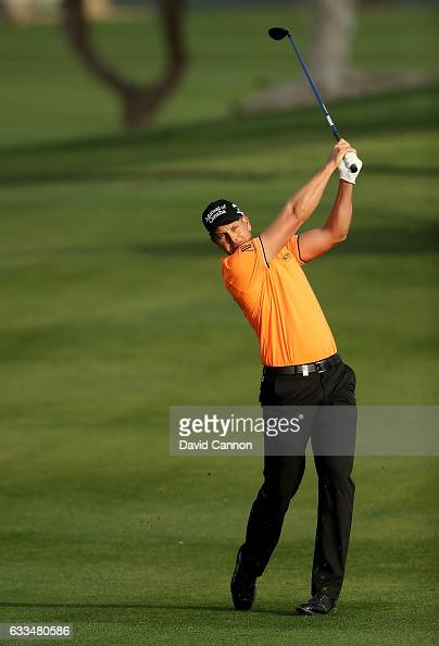 Henrik Stenson of Sweden plays his second shot to the par 5 10th hole during the first round of the 2017 Omega Dubai Desert Classic on the Majlis...