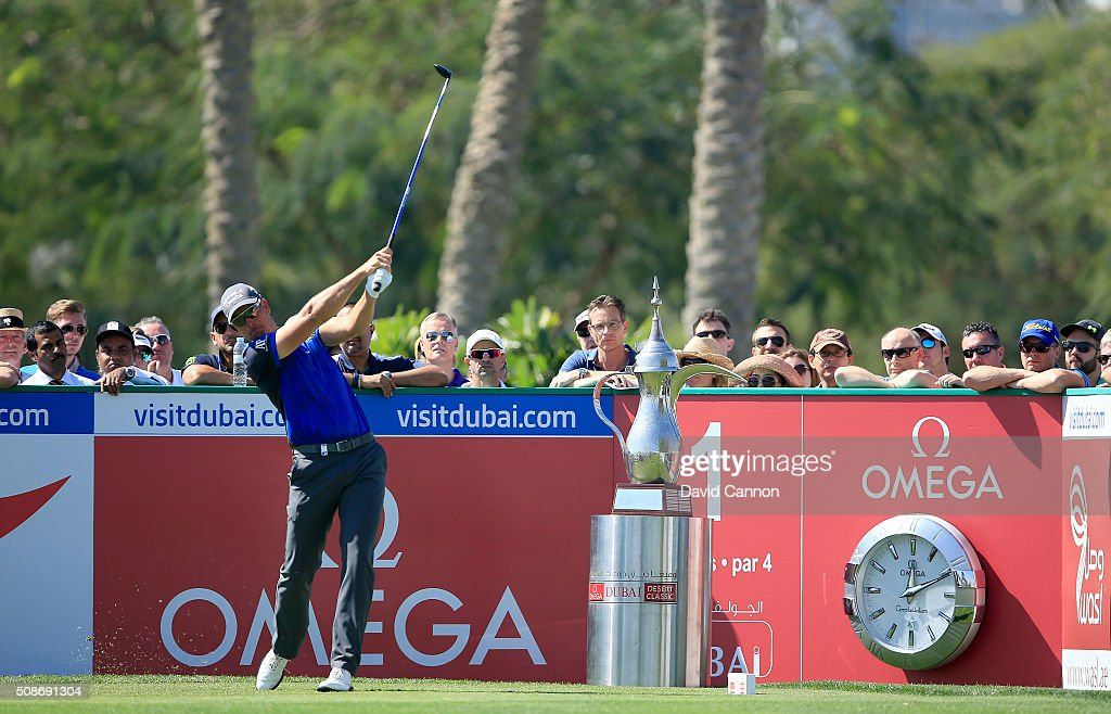 <a gi-track='captionPersonalityLinkClicked' href=/galleries/search?phrase=Henrik+Stenson&family=editorial&specificpeople=211537 ng-click='$event.stopPropagation()'>Henrik Stenson</a> of Sweden plays his tee shot at the par 4, first hole during the third round of the 2016 Omega Dubai Desert Classic on the Majlis Course at the Emirates Golf Club on February 6, 2016 in Dubai, United Arab Emirates.