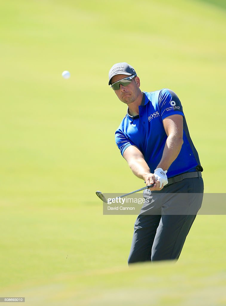 <a gi-track='captionPersonalityLinkClicked' href=/galleries/search?phrase=Henrik+Stenson&family=editorial&specificpeople=211537 ng-click='$event.stopPropagation()'>Henrik Stenson</a> of Sweden plays his third shot at the par 4, first hole during the third round of the 2016 Omega Dubai Desert Classic on the Majlis Course at the Emirates Golf Club on February 6, 2016 in Dubai, United Arab Emirates.