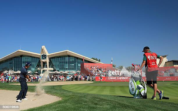 Henrik Stenson of Sweden plays his third shot at the par 4 ninth hole during the first round of the 2016 Abu Dhabi HSBC Golf Championship at the Abu...