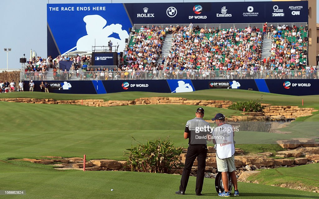 <a gi-track='captionPersonalityLinkClicked' href=/galleries/search?phrase=Henrik+Stenson&family=editorial&specificpeople=211537 ng-click='$event.stopPropagation()'>Henrik Stenson</a> of Sweden plays his third shot at the par 5, 18th hole during the second round of the 2012 DP World Tour Championship on the Earth Course at Jumeirah Golf Estates on November 23, 2012 in Dubai, United Arab Emirates.