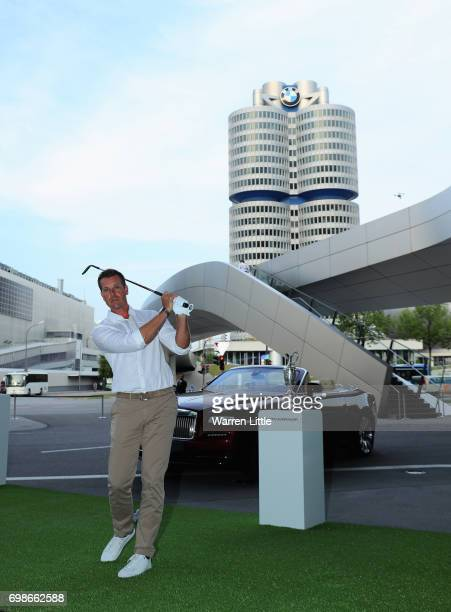 Henrik Stenson of Sweden poses for a picture as he shows off his chipping skills at the proam prize giving at BMW Welt ahead of the BMW International...