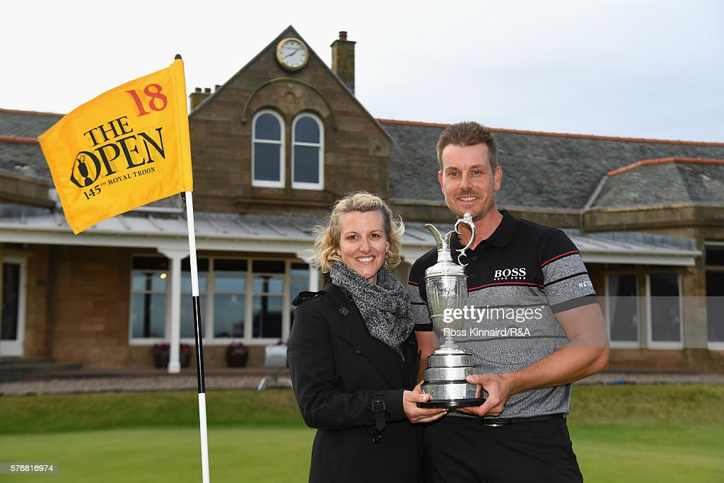 Henrik Stenson of Sweden poses with his wife Emma Stenson and the Claret Jug following his victory during the final round on day four of the 145th Open Championship at Royal Troon on July 17, 2016 in Troon, Scotland.